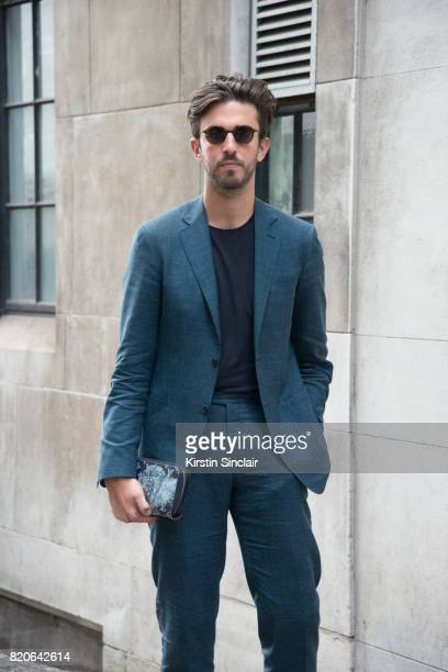 Style Director Teo Van Den Broeke wears a Canalli suit Cos T shirt Louis Vuitton clutch bag and Thom Browne sunglasses on day 1 of London Collections...