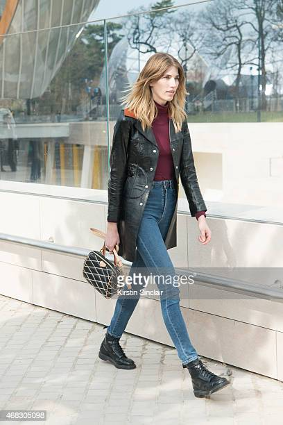 Style editor at Harper's Bazaar Germany Veronika Heilbrunner wears a Louis Vuitton bag and jacket and Dr Martens shoes on day 9 of Paris Collections...