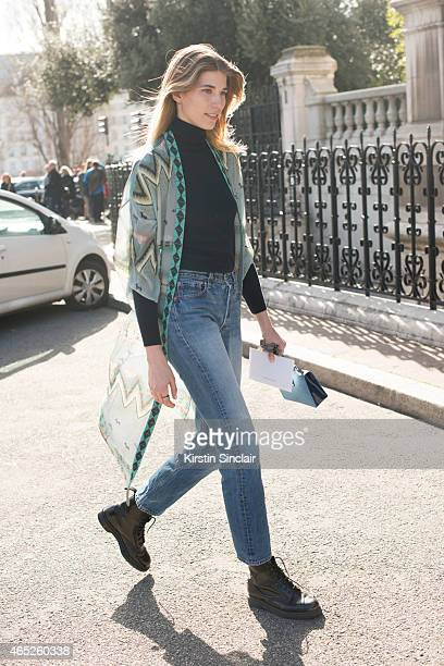 Style editor at Harper's Bazaar Germany Veronika Heilbrunner wears Etro kimono Jimmy Choo bag vintage Levi's Uniqlo turtle neck and Dr Martens shoes...