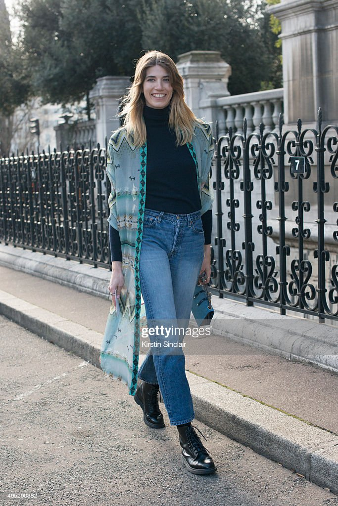 Style editor at Harper's Bazaar Germany Veronika Heilbrunner wears Etro kimono Jimmy Choo bag vintage Levi's Uniqlo turtle neck and Dr Martens shoes...