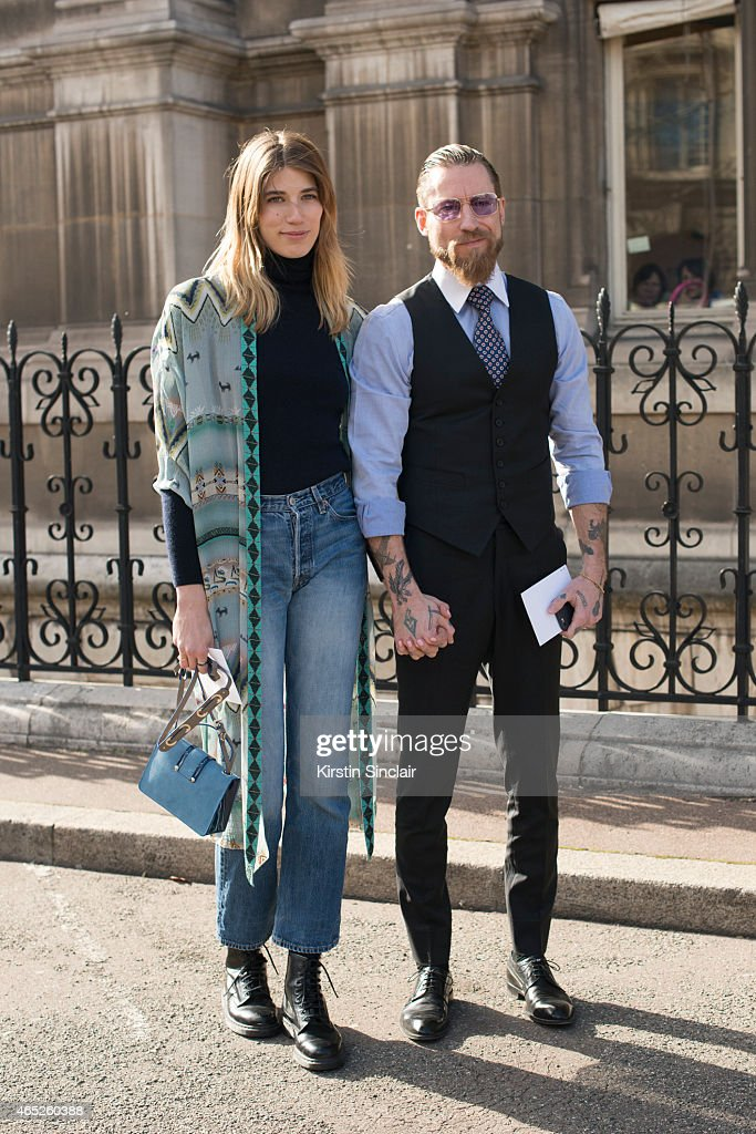 Style editor at Harper's Bazaar Germany Veronika Heilbrunner wears Etro kimono, Jimmy Choo bag, vintage Levi's, Uniqlo turtle neck and Dr Martens shoes with buying director for Mytheresa.com Justin O'Shea on day 2 of Paris Collections: Women on March 04, 2015 in Paris, France.