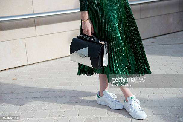 Style Editor for Hollywood Reporter Carol McColgin wears a Christopher Kane skirt and sweater Fendi bag celine sunglasses and Adidas trainers on day...