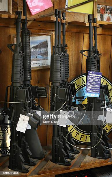 AR15 style rifles are offered for sale at Freddie Bear Sports sporting goods store on December 17 2012 in Tinley Park Illinois Americans purchased a...