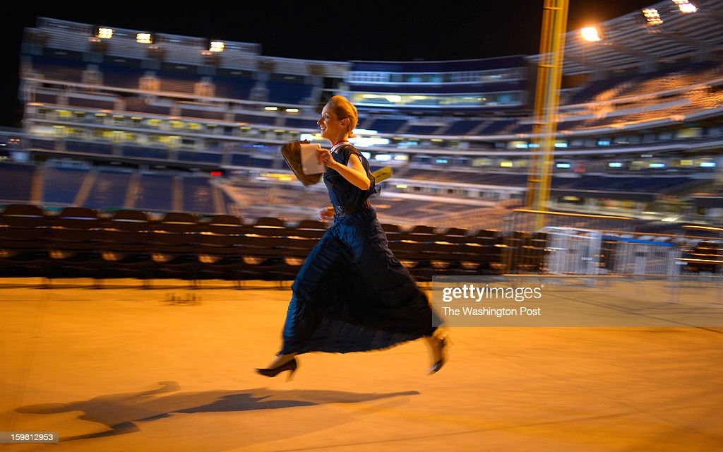 Style writer Monica Hesse dashes past the National's baseball field to her car after she covered the North Carolina Ball at Nationals Stadium. She raced from inaugural ball to ball against fellow writer Dan Zak during a treasure hunt competition in Washington DC, January 194, 2012 .