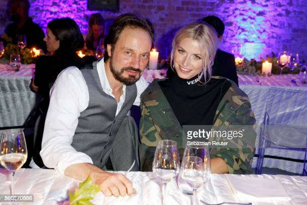 Stylebopcom founder Mario Eimuth and Lena Gercke attend the Moncler X Stylebopcom launch event at the Musikbrauerei on October 11 2017 in Berlin...