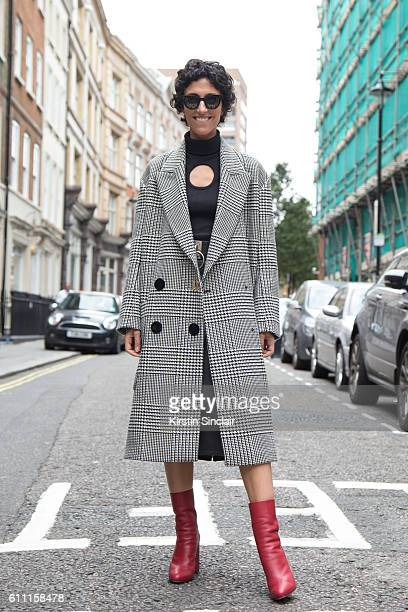 Stylecom Fashion Director Yasmin Sewell wears a Petar Petrov Vienna coat and Celine glasses on day 3 of London Womens Fashion Week Spring/Summer 2017...