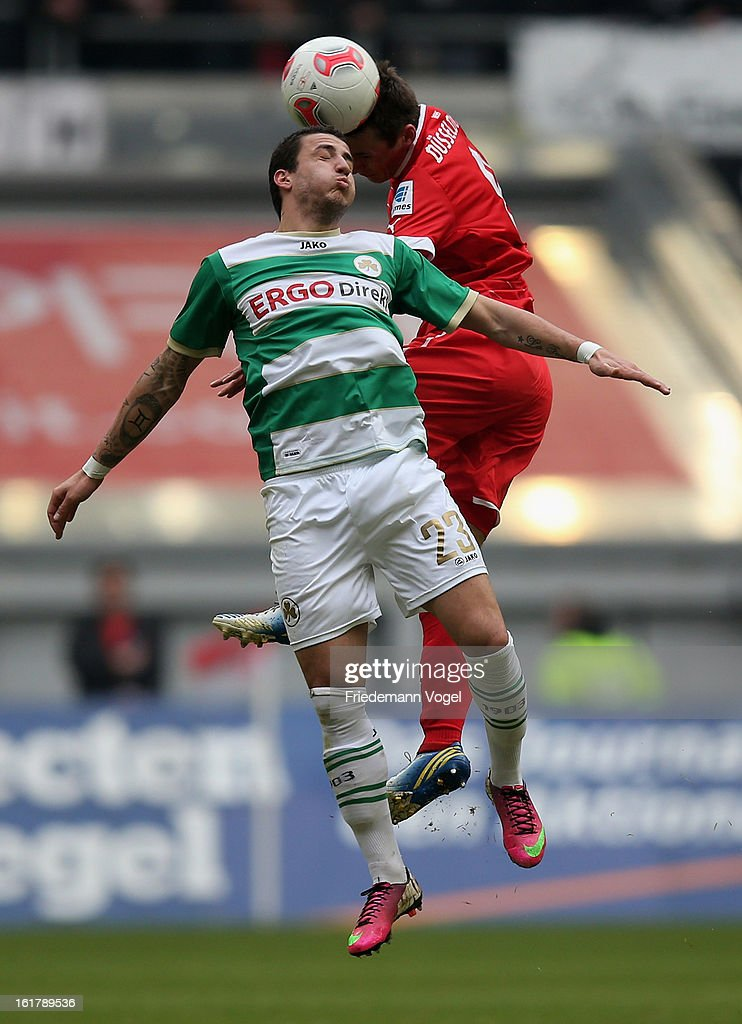 Stylianos Malezas of Duesseldorf (R) and Sercan Sararer of Fuerth compete for a header during the Bundesliga match between Fortuna Duesseldorf 1895 and SpVgg Greuther Fuerth at Esprit-Arena on February 16, 2013 in Duesseldorf, Germany.