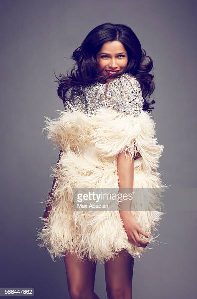 Styling by Elizabeth Cabral hair by Johnny Lavoy and makeup by Martin Maulawizada Tulle/ostrich feather dress by Naeem Khan and cuff by Repossi