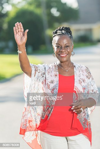 Stylish, African American woman standing outdoors : Stock Photo
