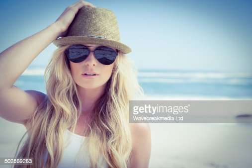 Stylish blonde looking at camera on the beach : Stock Photo