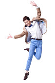Stylish businessman jumping with excitement