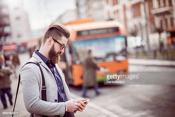 stylish businessman using his smartphone