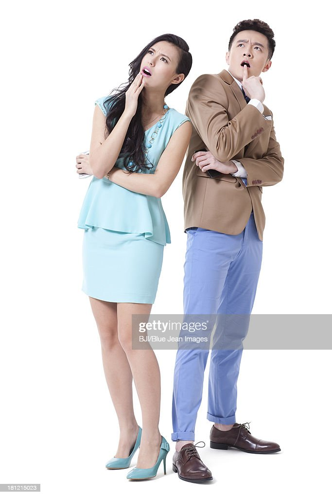 Stylish businesspeople looking puzzled and surprised : Stock Photo