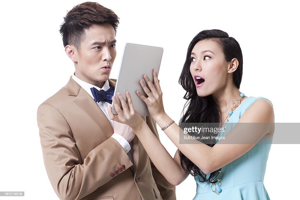Stylish businesspeople with digital tablet : Stock Photo