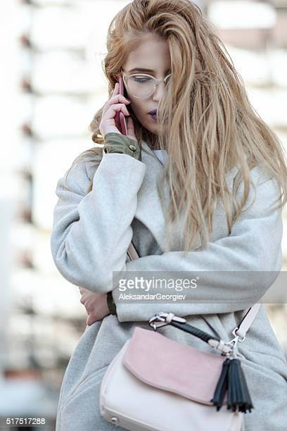 Stylish Businesswoman Talking on Mobile Phone Outdoor in the City