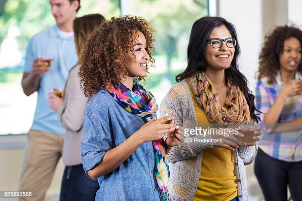 Stylish college students meeting during party at sorority house