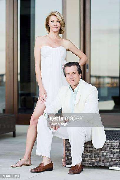 Stylish couple wearing summer resort wear