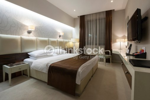 Stylish double bed hotel room stock photo thinkstock for Stylish hotel rooms