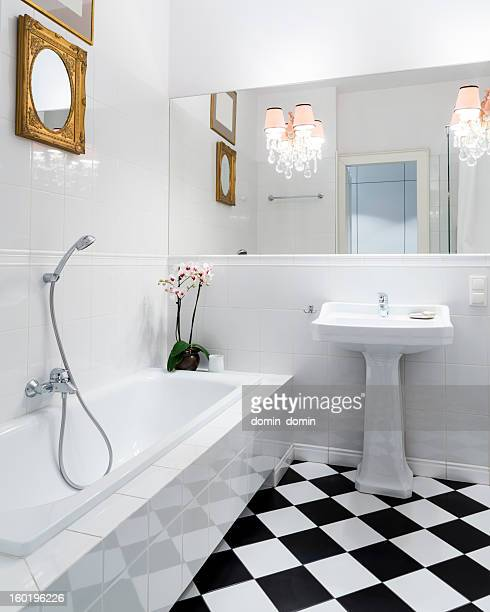 Stylish, elegant, black and white bathroom interior with checkered patterns