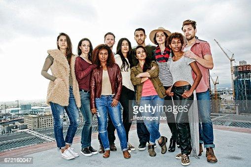 Stylish friends posing on urban rooftop