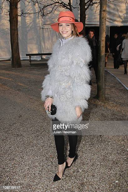Stylish guest arrives at the Lanvin fashion show with a Chloe coat Zara shoes and a Maison Michel hat during the Paris Fashion Week Fall/Winter 2012...