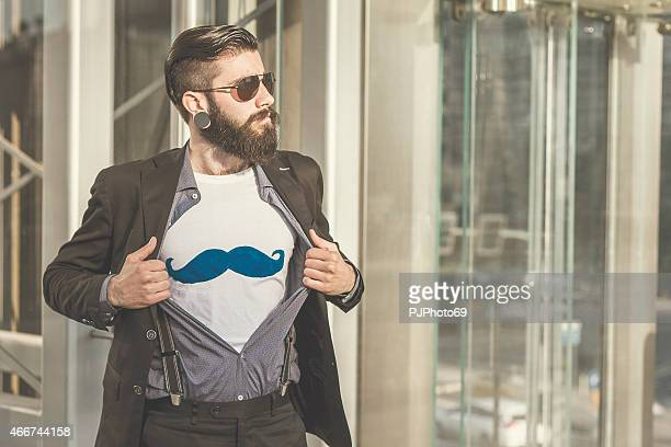 Stylish Hipster showing mustaches on t-shirt