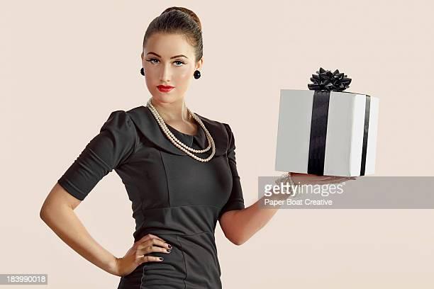 Stylish lady holding one black and white gift box