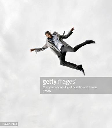 Stylish man falling through the air gracefully