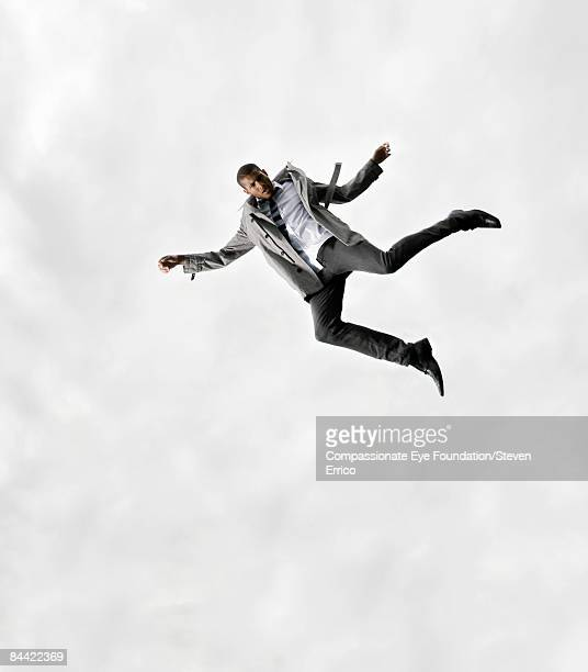 Stylish man falling through the air gracefully