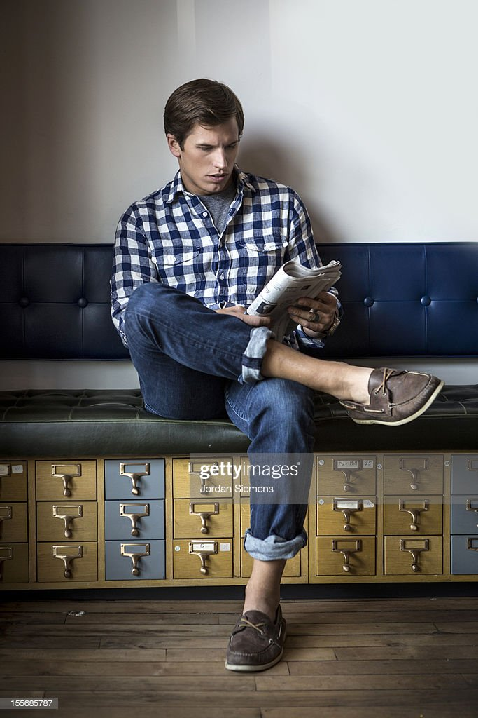 Stylish man reading a newspaper. : Stock Photo