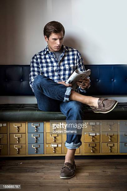 Stylish man reading a newspaper.