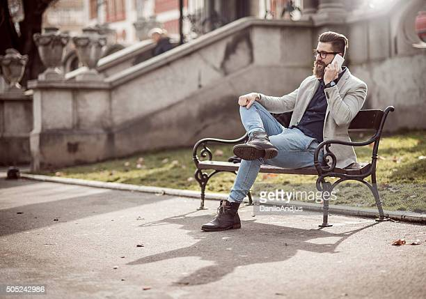 stylish man relaxing and talking on the phone
