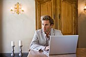 Stylish man using laptop