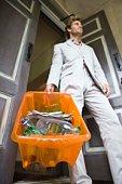 Stylish man with recycling bin