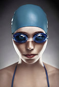 Stylish portrait of  young woman in goggles and swimming cap