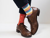 Stylish, vintage, brown shoes and bright, funny, happy socks on a white background. Style, fashion, beauty