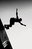 Skateboarder in black and white.