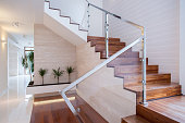 Image of stylish staircase in bright house interior