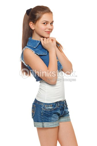 Stylish Teen Girl In A Jeans Vest And Denim Shorts Stock Photo ...