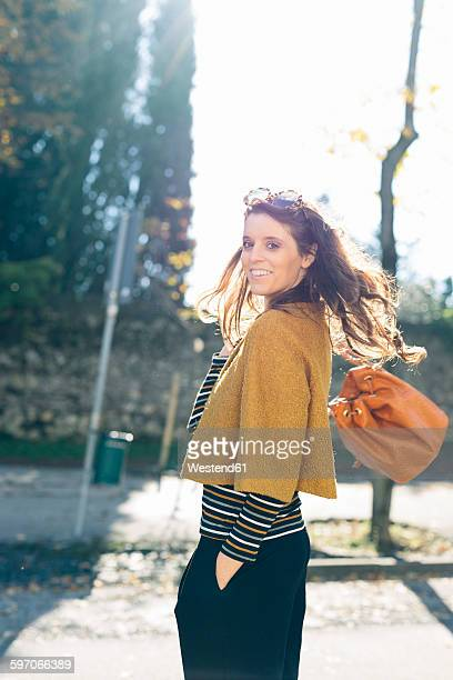 Stylish woman at the park on a sunny autumn day