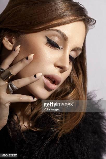 Stylish woman touching her face sensually