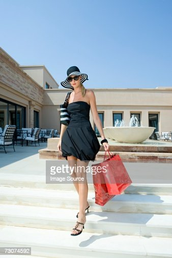 Stylish woman with shopping bags : Bildbanksbilder