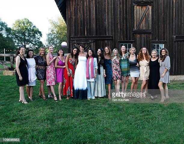 Stylish women line up around bride at reception