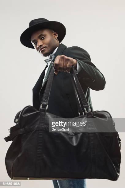 Stylish young african man with handbag