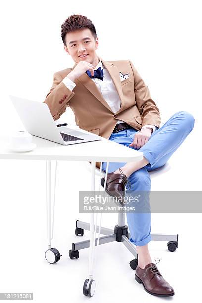 Stylish young businessman in office