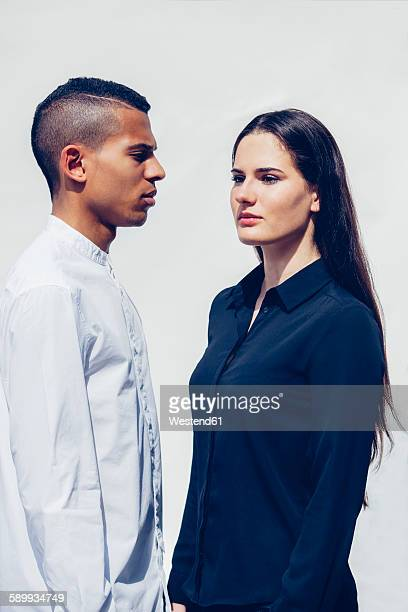 Stylish young couple in front of white background