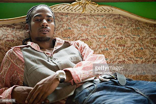Stylish young gentleman reclining