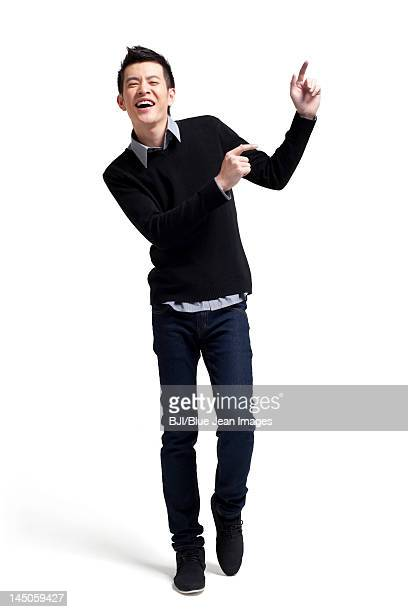 Stylish young man dancing