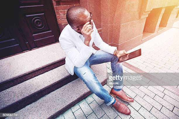 Stylish young man using tablet pc