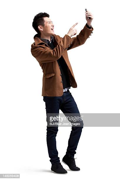 Stylish young man with moblie phone